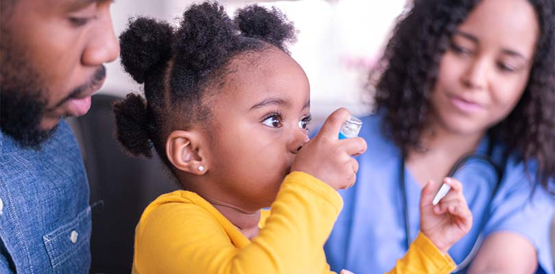A child using an inhaler for asthma.